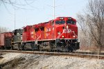 CP 8128 and train 280 roll eastward out of town