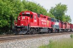 CP 4599 fronts the classic and colorful EMD lashup hauling westbound weed sprayer train 2WWA-03