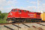 CP 8135 has the signal and gets Train 199 on the move again