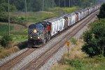 CEFX 1038 leads westbound unit grain empties train 381