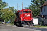 CP 2326 continues north away from the camera along Wall St.