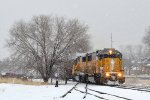 The southbound Cache Valley Local (LUG-41C) powered by SD-60 #2235 & SD-62 #2212 has just crossed W. 200 N. and is heading for the tie down point (Cafe Sabor, The Old Station) in Logan, UT. December 14, 2016.