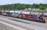 Two leasers sandwitching a CSX unit bring a freight train into CSX Tilford