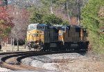 CSX C40-8W 7389 and UP SD70Ms 4590 and 4174 round the curve