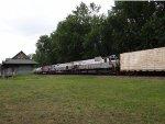Old locomotives passing and even older station