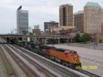 BNSF 5398 leads empty NS coal train.