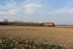 BNSF 6590 Crawls south with a loaded rock train.