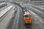 BNSF 6197 leads the KCKGAL east in the pouring rain.