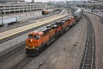 BNSF 7074 leads an eastbound stack past KC Union Station