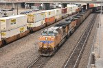 UP 5939 Leads a empty coal past a BNSF stack train.