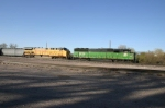 BNSF 9229 and UP friend wait with cars from the DM&E