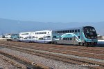 SCAX 863 (F59PH) with a four car commuter train is just moments away from its final destination at the San Bernardino depot. Rana CA. 6/3/2018