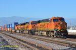 A BNSF stack train headed for Los Angeles has a mixed bag of GE Gevo's for power a ES44DC-ET44C4 and a ES44AC, the AC Gevo is more at home on slow heavy coal trains rather than fast Intermodal trains. Rana CA. 6/3/2018