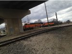 BNSF 6781 heads under IL Route 7.
