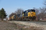 CSX 3263 leads Q326 east past the backlots of Grandville