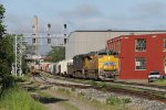 UP 8717 leads the way as D702 moves through Sunnyside on Main 1