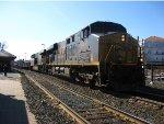 CSX 5496 leads a baretable train east
