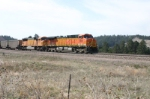 BNSF 5688 marches more empties to the basin