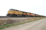 UP 7005 heads a JECX train