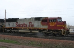 BNSF 8235 is leader on a parked coal train