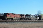 Westbound mixed freight waiting on Quebec Street yard
