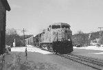A primer GEVO leads an Autorack train east