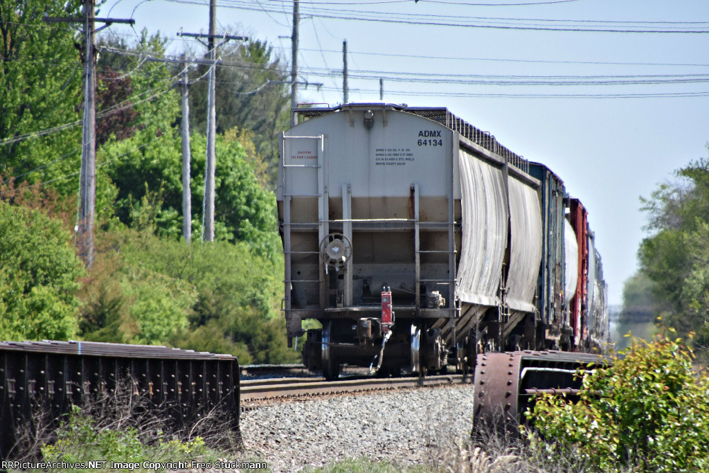 ADMX 64134 is new to rrpa and trails this eastbound mixer.