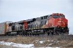 Westbound vehicle train waits to enter Symington Yard