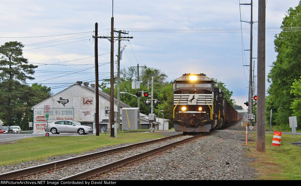 DCR-1/NS 62W (loaded stone) southbound train with NS SD60E #7019 lead