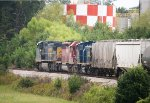 CSX C40-8W 7887, HLCX SD40-2 7203, and MP15T 1230 pass CertainTeed