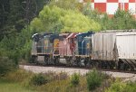 CSX C40-8W 7887 and HLCX SD40-2 7203, with MP15T 1230 in tow, head northbound