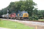 CSX C40-8W 7887, HLCX SD40-2 7203, and MP15T 1230 pass the Crestwood Road signals