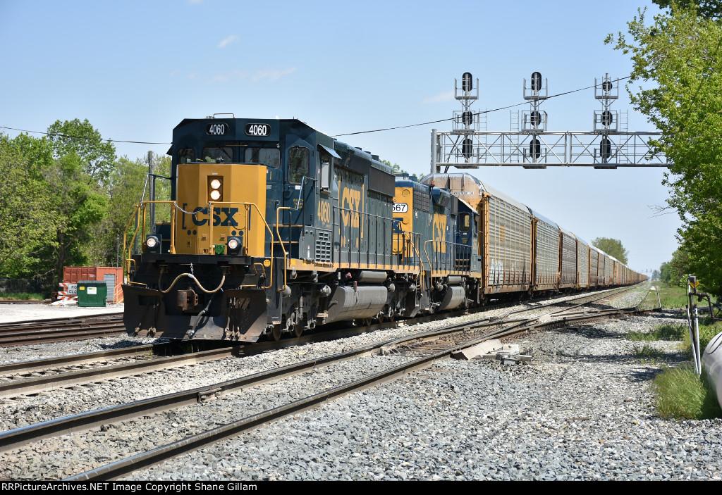 CSX 4060 Drags a 2 mile long rack train west into Fostoria Ohio.