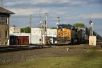 CSX 972 Drags a stack train west into the sun.