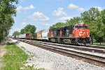 CN 2326 Rolls down the ex Ic main toward Tuscola IL.