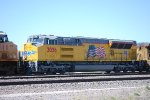 Zoomed in shot of UP 3036 as She waits to head east as the UP Rawlins Fuel Pit Crew Fill the Mid-DPU Units.