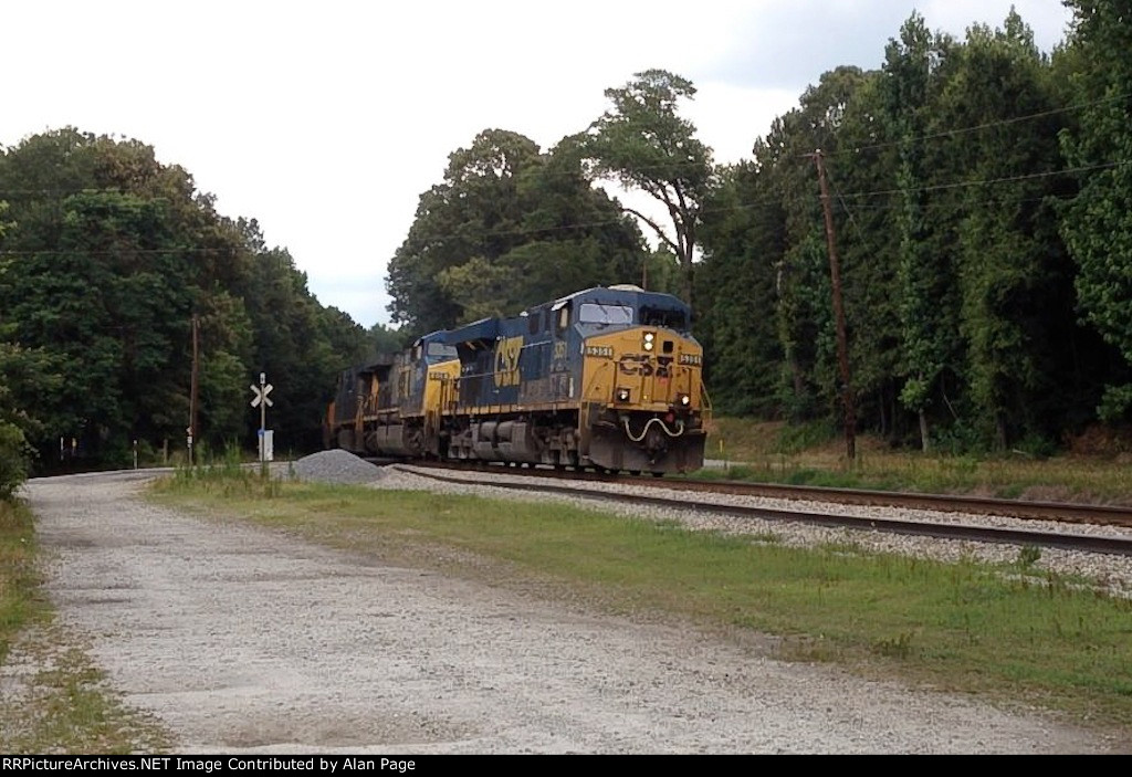 CSX ES40DC 5351, AC60CW 609, and ES40DC 5485 blast out of the woods across the Westbrook Road crossing