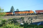 BNSF 3738 Heads westbound with Her Loaded Grain Train.