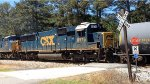 CSX SD50-2 8576 rolls across a private crossing