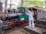 To a rapt audience, Fireman Cathy Orne adds coal to the left-side pannier-style bunker
