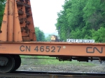 BNSF 4416 Looks on as Rail Transport Flat Cars Move Past