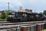 A tier 4 leads a northbound into a summer storm