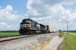 A westbound NS manifest charges through the fields of Ohio