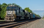 Two different SD70 models hustle a tanker train west for a refill