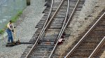 """Trainman lines the """"middle"""" switch in the yard at Kemper St."""