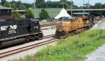 PM01 yard job pulls up along side the disabled NS research train