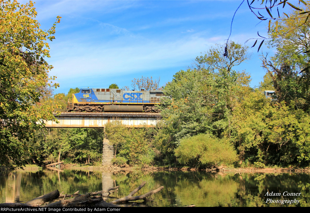 CSX Q648 (Waycross, GA - Chicago, IL (BRC)) crossing the Stones River in Murfreesboro, TN. CSX AC44CW 448 is leading CSX ES40DC 5445 and CSX SD40-3 4079 and a long string of mixed freight.