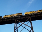 Two AC45CCTE's Give Aid to a UP Partner in Pulling an Intermodal Doublestack Train Over the Kate Shelley Bridge