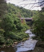 The Gouldsboro excursion train crosses Roaring Brook on the high trestle at the bottom of Nay Aug Gorge.