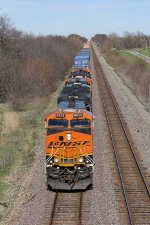 A trio of BNSF C4 units power Q-CXOLAC1 across western Illinois